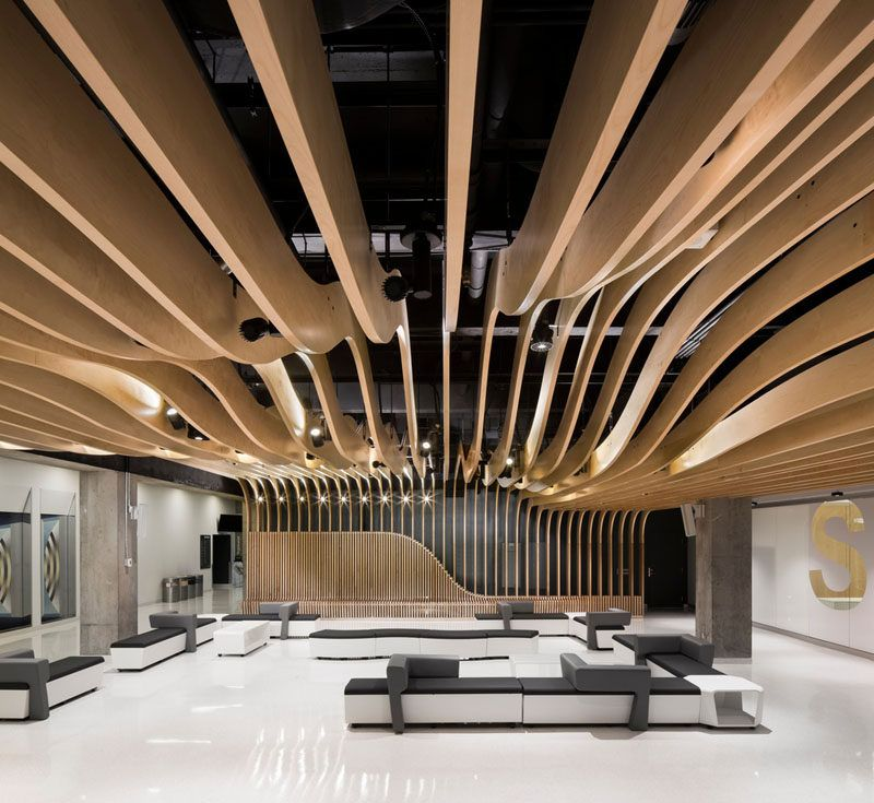 Interior Design Office Montreal: The Seat Along The Wall Becomes A Dramatic Sculptural Wood