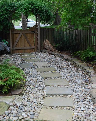 Concrete stepping stones with gravel outdoors - River stone walkway ideas seven diy projects ...