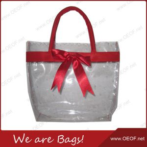 Fashion Lady PVC Handbag with Satin Butterfly (11156) on Made-in-China.com  We are Bags! Fashion Tote Bag, material: Clear PVC; Trim: PVC leather; Size: 24*28*10CM; MOQ: 2000pcs; Color: Gold; Specific color and customized styles are welcomed!