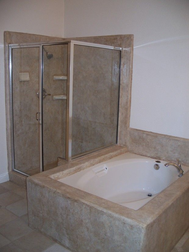 Decorative concrete overlay over tile on shower and for Tile shower surround