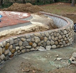 Image Result For Covering Concrete Blocks With Mud Facade On Garden Retaining Wall In Australia Retaining Wall Retaining Wall Construction Stone Wall Design