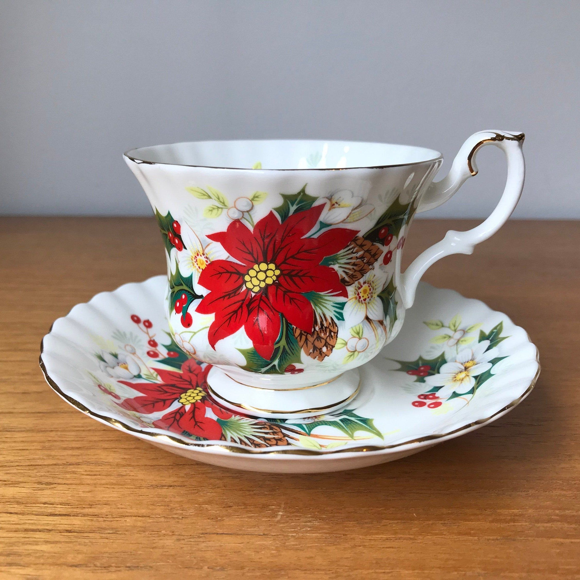 s Royal Albert Poinsettia Tea Cup Vintage England Made Excellent Holly Berry Yuletide Christmas Holiday and Saucer s