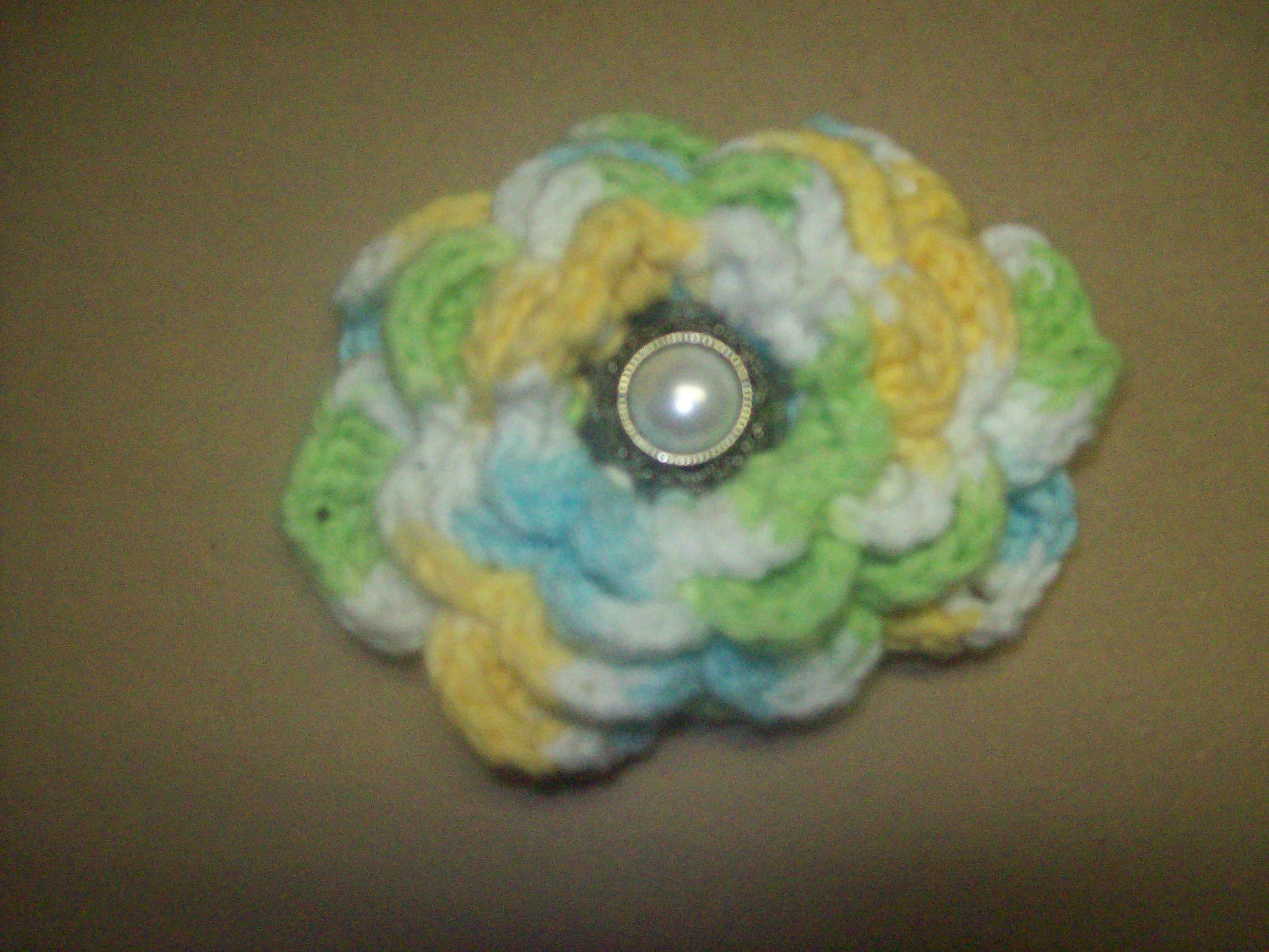 """Bow made from crochet rose and old """"pearl"""" button."""
