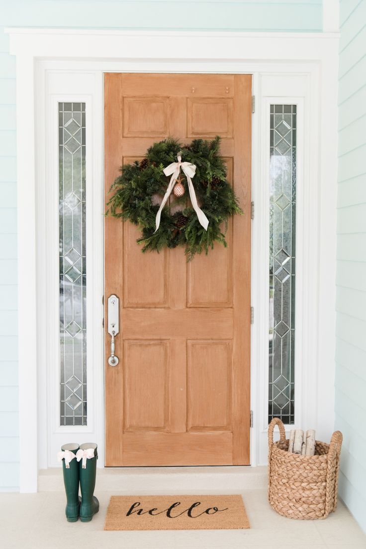 holiday decor for your front door  Photography : Shea Christine Photography Read More on SMP: http://www.stylemepretty.com/living/2016/12/13/how-to-decorate-for-the-holidays-using-absolutely-no-red/