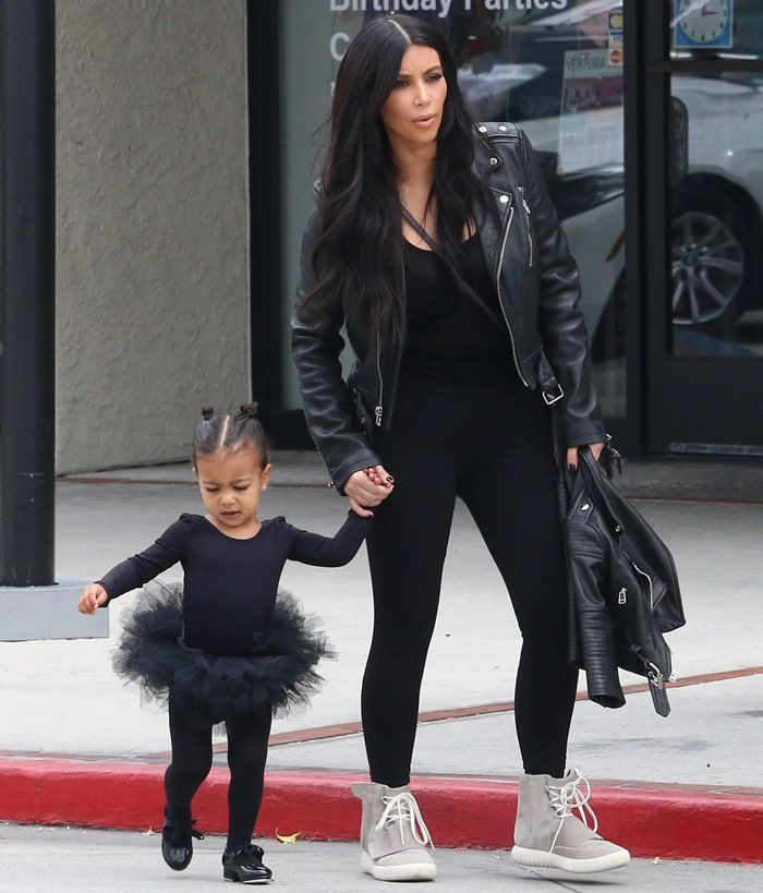 Kim Kardashian in Kanye West x Adidas Originals Yeezy 750 Boost Sneakers