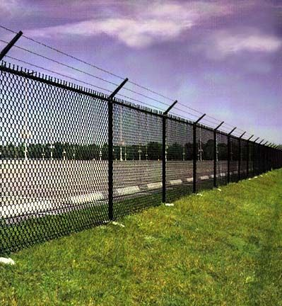 A Chain Link Fence Topped With Three Strands Of Barbed Wire Functions As A Great Choice To Define Y Chain Link Fence Chain Link Fence Installation Fence Design