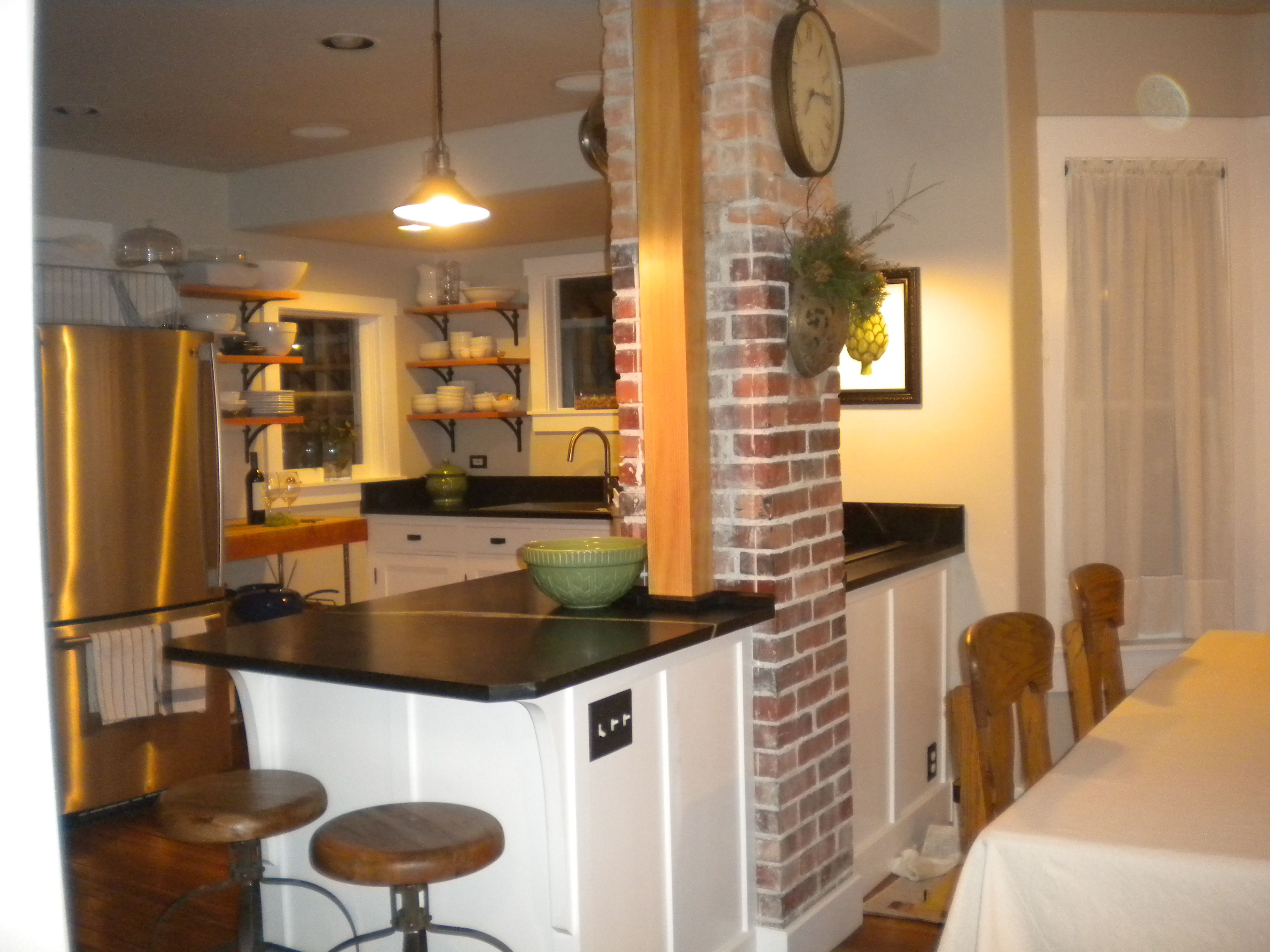 Updated kitchen in an 1895 cottage. Soapstone counters, open shelving.