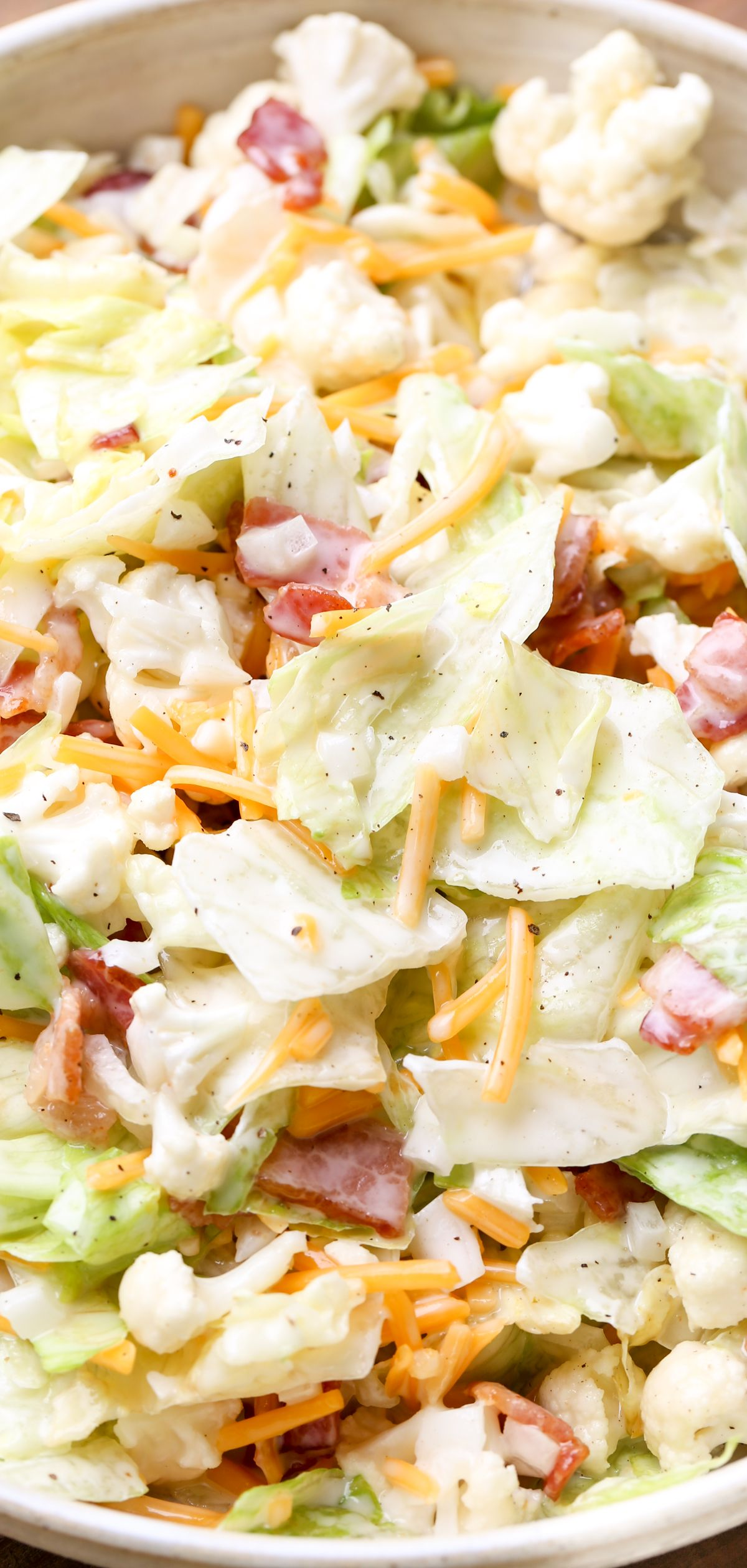 Salad with lettuce, cauliflower, and bacon. Delicious ...