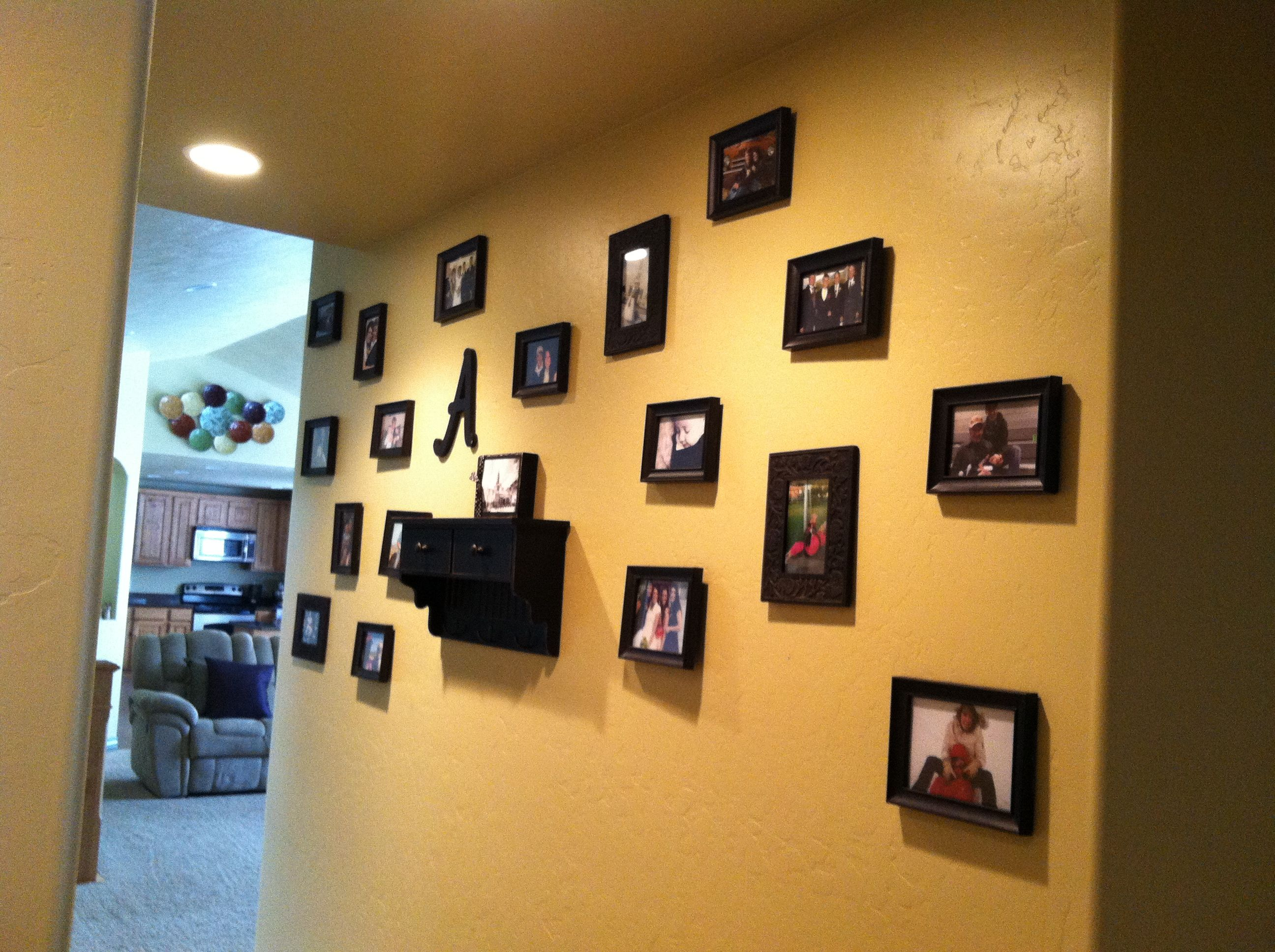 DIY photo colleague wall. All frames are from the dollar store. A ...