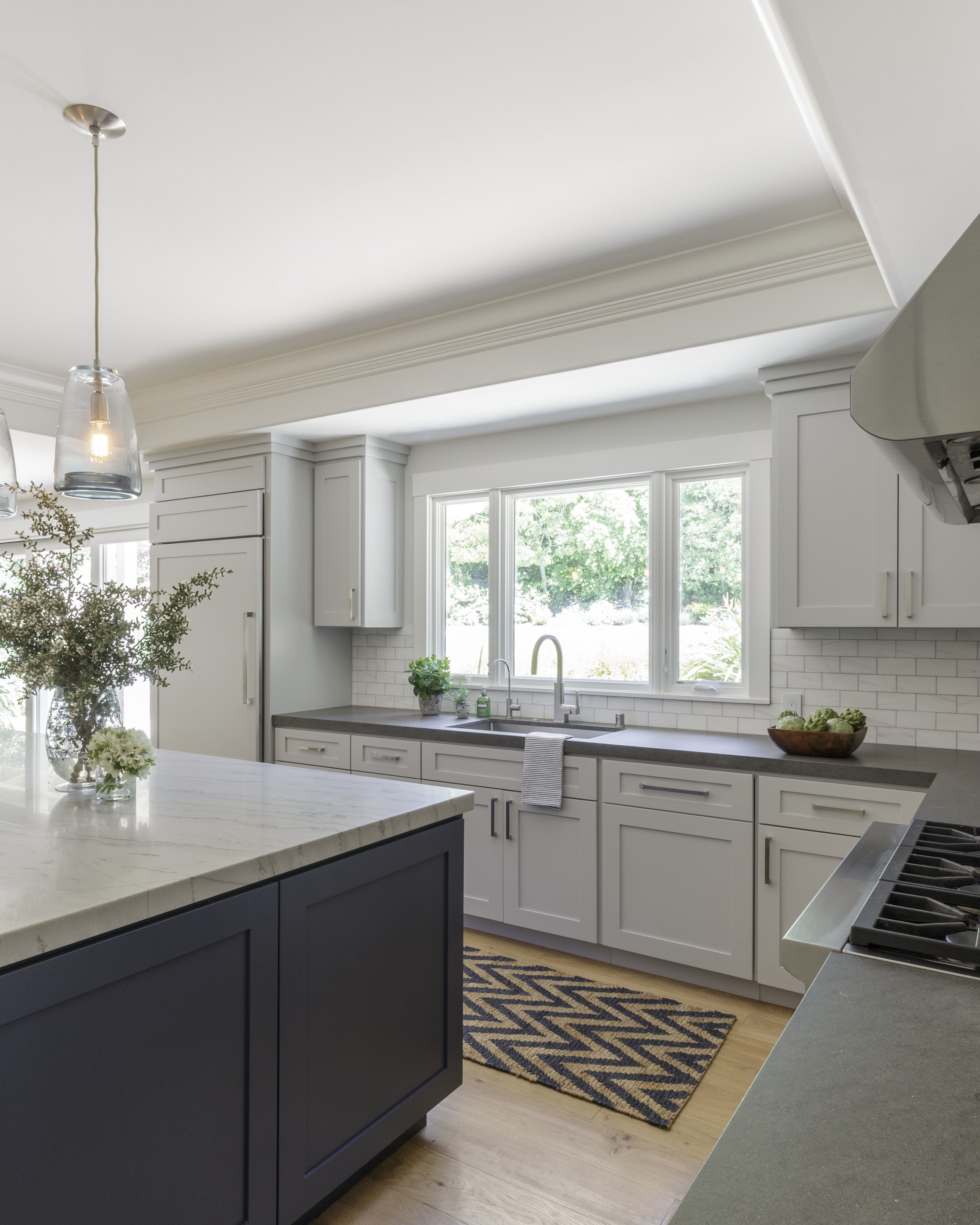 The Custom Navy Blue Island Is A Perfect Contrast To The Soothing Grey Cabinetry Light Gray Cabinets New Kitchen Cabinets White Kitchen Navy Island