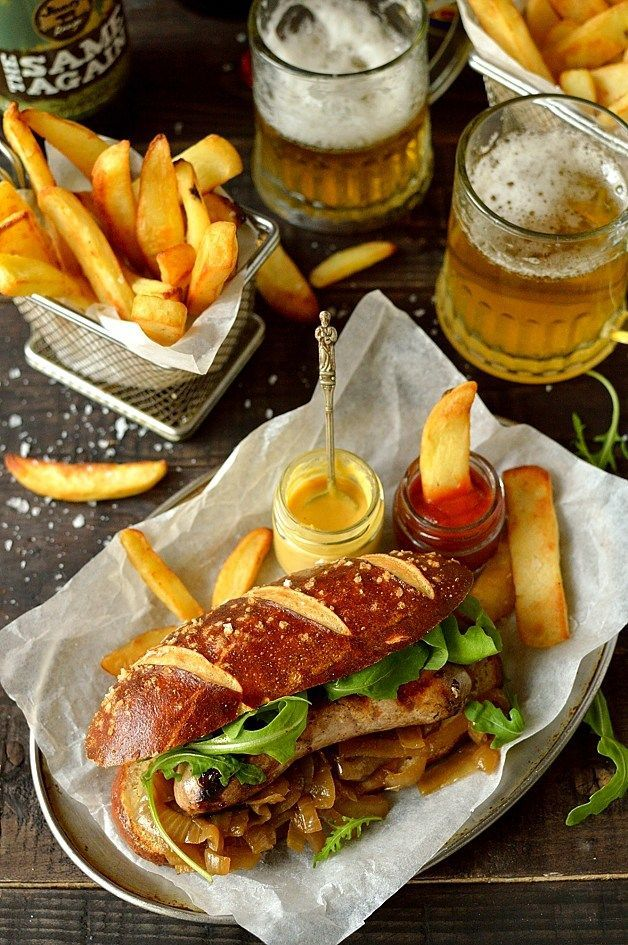 Sausages with beer pretzel hot dog buns, beer braised onions and ...