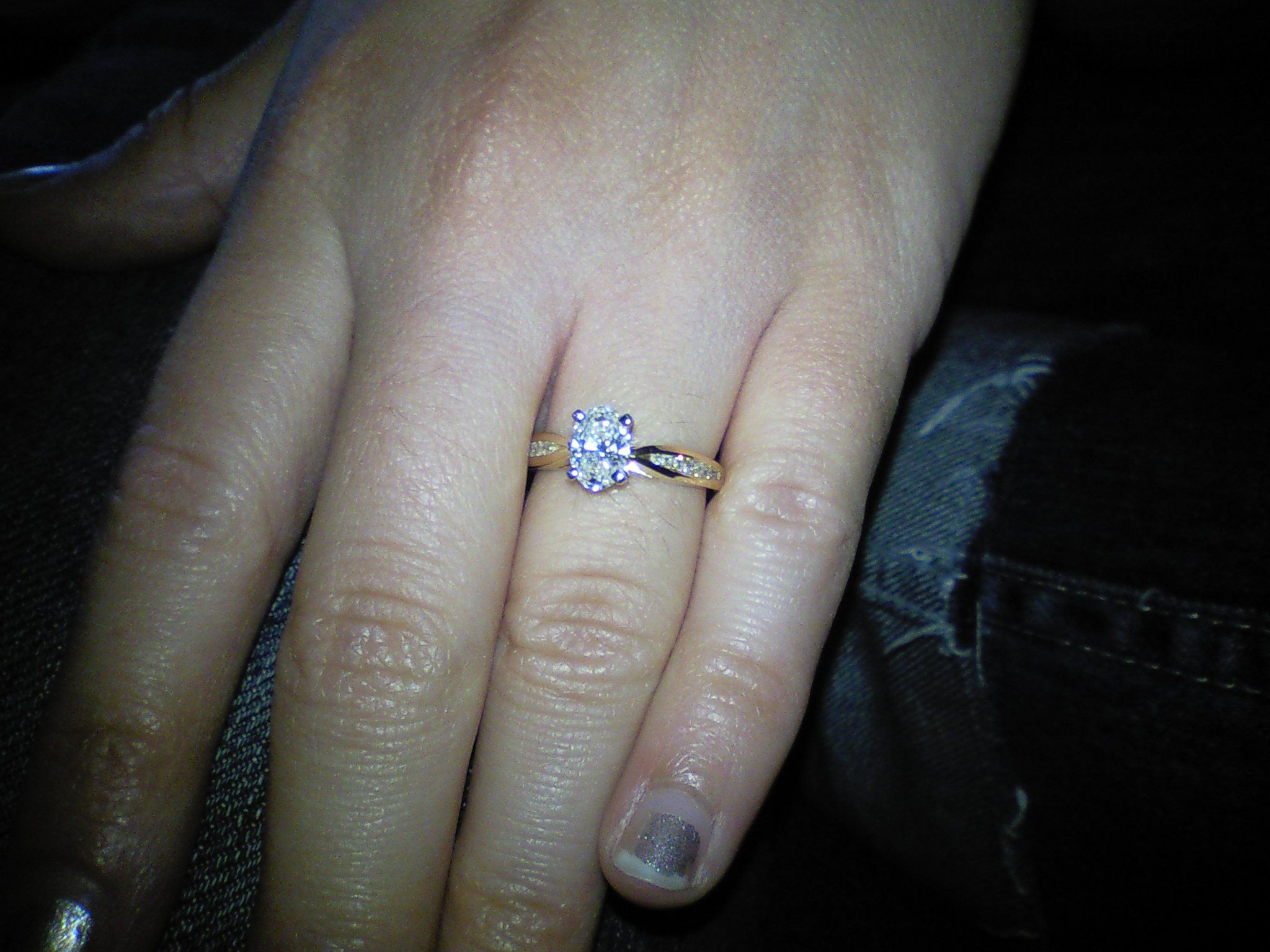 Website where I picked out my top 3 favorite engagement ring designs then pleasantly surprised which one he had customized for me.  <3  [sorry for the poor nail job]  http://www.engagementglobal.com/