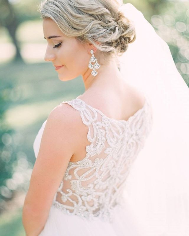 An illusion back and intricate beading? This @maggiesotterodesigns wedding dress has us completely mesmerized! #sponsored | Photography: @tracyenoch | Wedding Dress: @maggiesotterodesigns | Hair + Makeup: @janetdesignshair