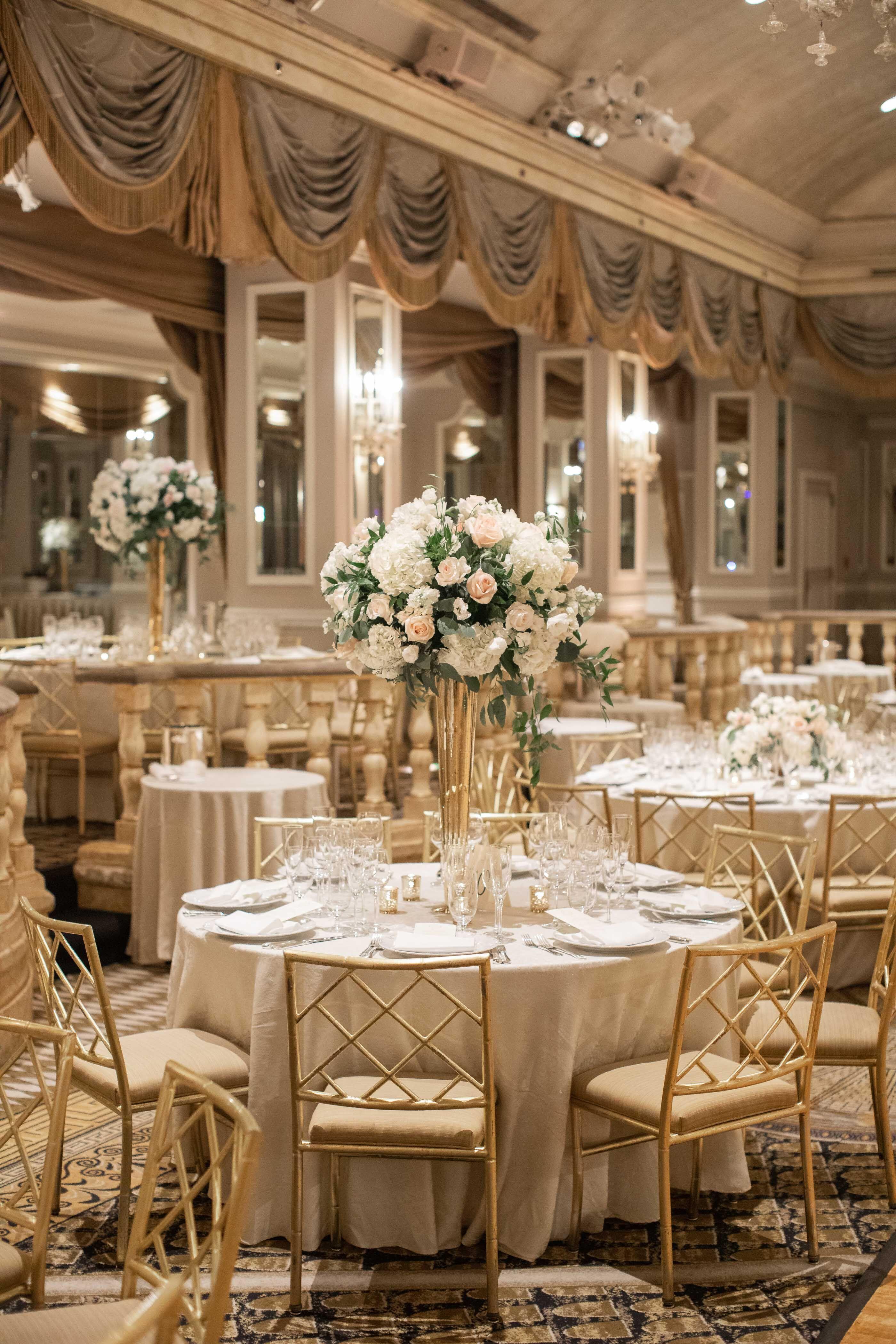Elegant NYC ballroom wedding with towering floral ...