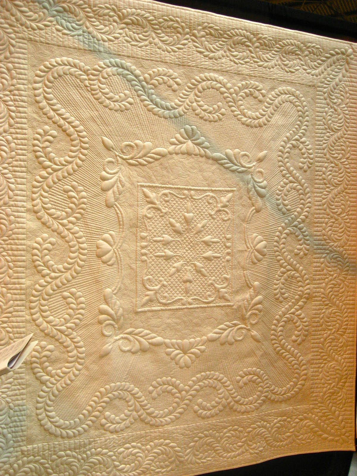 """""""Wholecloth One"""" by Robin Fahy, 2011 Festival of Quilts (UK).  Trapunto and machine quilting. Posted by holdingmummyshand"""