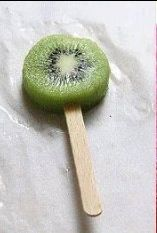 Then put the kiwi on a Popsicle stick