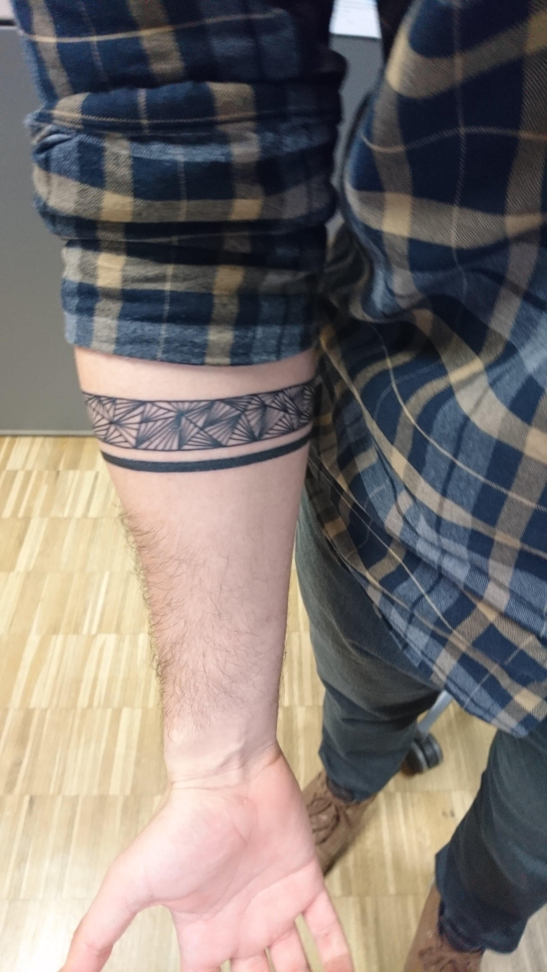 Geometric arm band tattoo by aldina light bearer tattoo