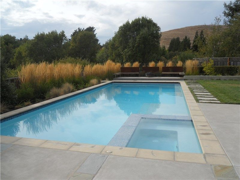 Contemporary pool with poured in place coping and Ann Sacks Glass Tile.  Designed by Aqua-Link Pools and Spas and A Yard to You.