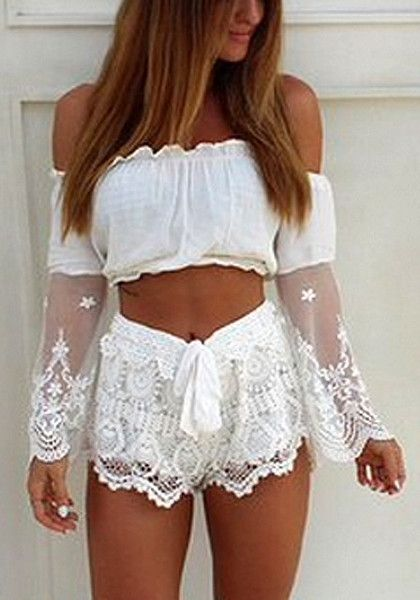 Model in white off shoulder crop top and lace shorts
