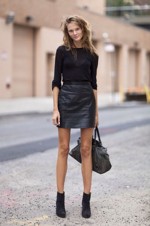 Tops [Sweaters] (black) Skirts (leather, black, high waisted) Boots (black, ankle boots, heeled) Accessories [Bags] (black, leather)