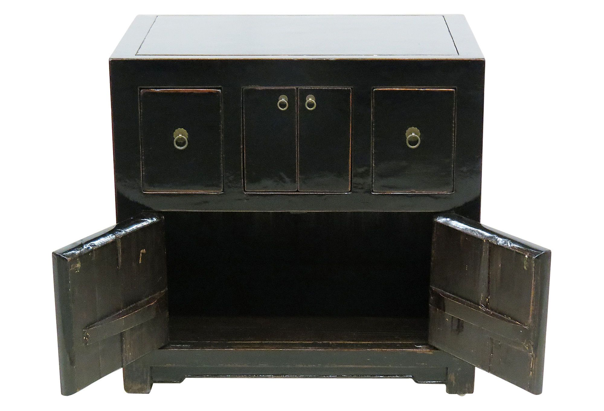 This chest was meticulously handcrafted of elm wood reclaimed from furniture that dates back to China's Qing Dynasty, which came to an end with the 1911 revolution. The distinctive silhouette, carved details, and distressed finish speak to its heritage