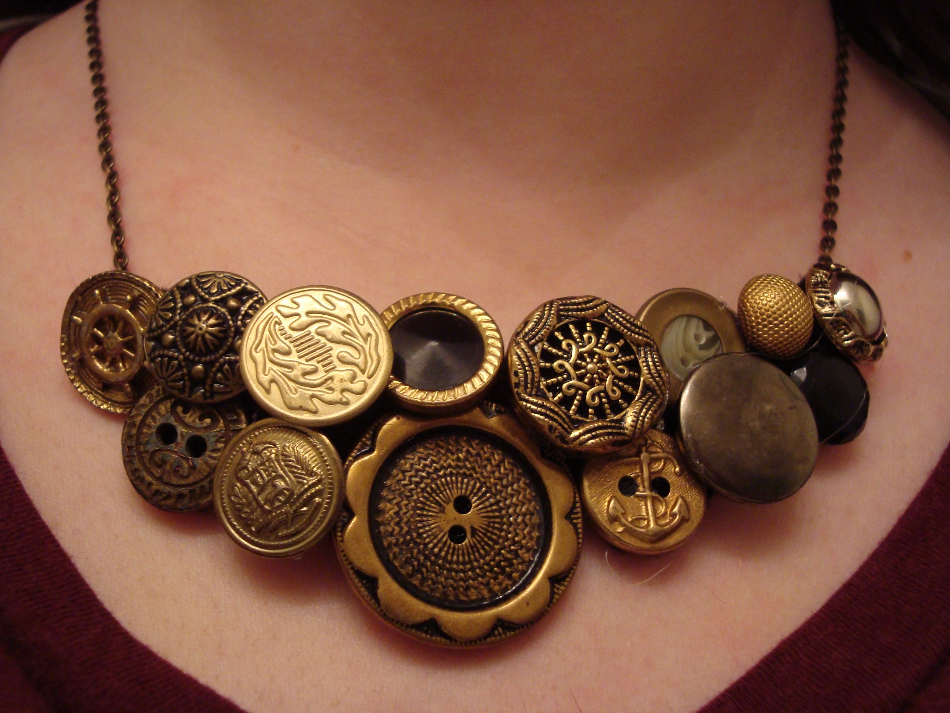 DIY Vintage Button Necklace // Hot-glue buttons onto felt, cut around the design, sew on a chain, and voila! Statement necklace.