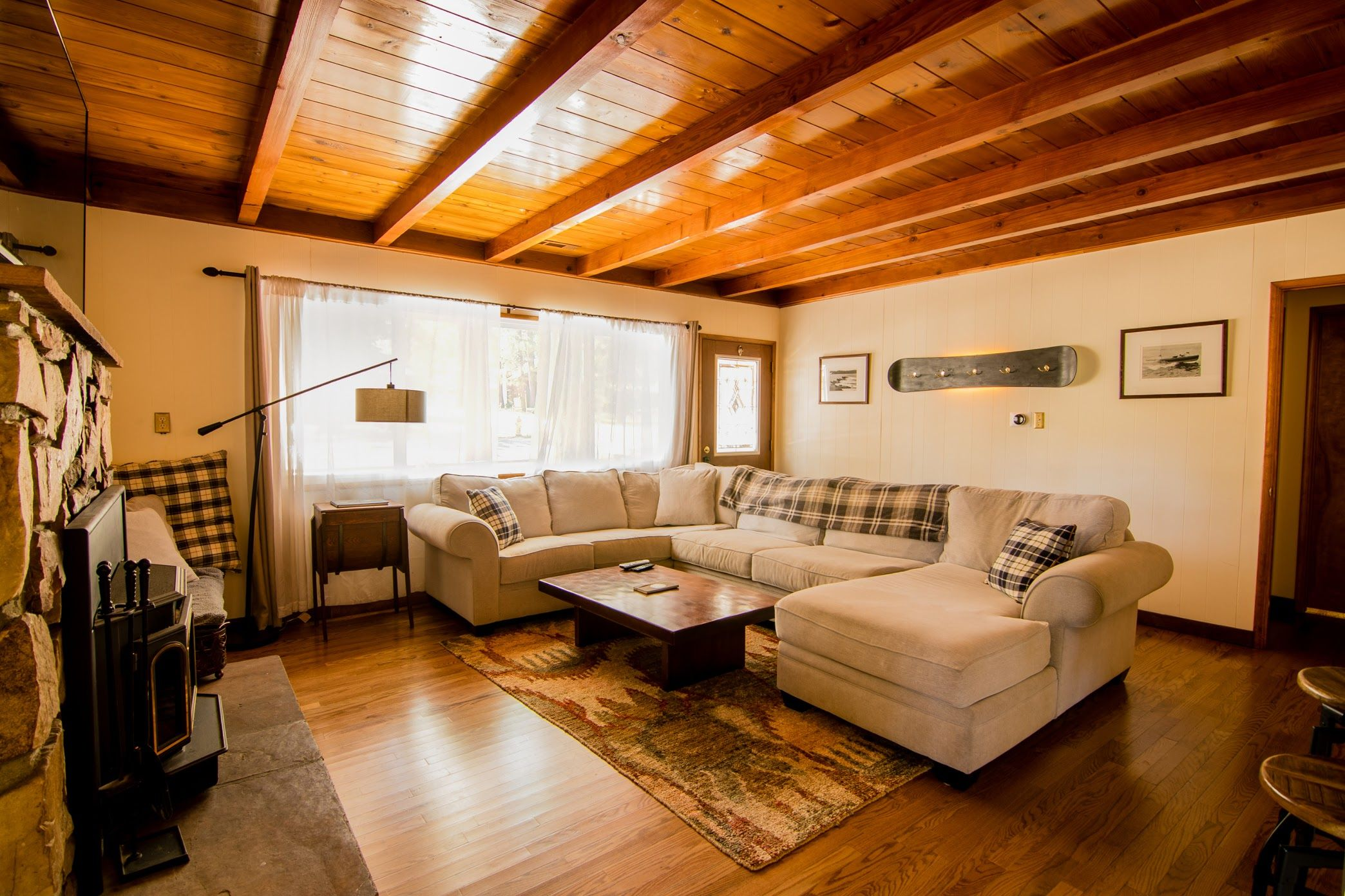 The living room features  large sectional and plenty of natural light from porch also rh pinterest