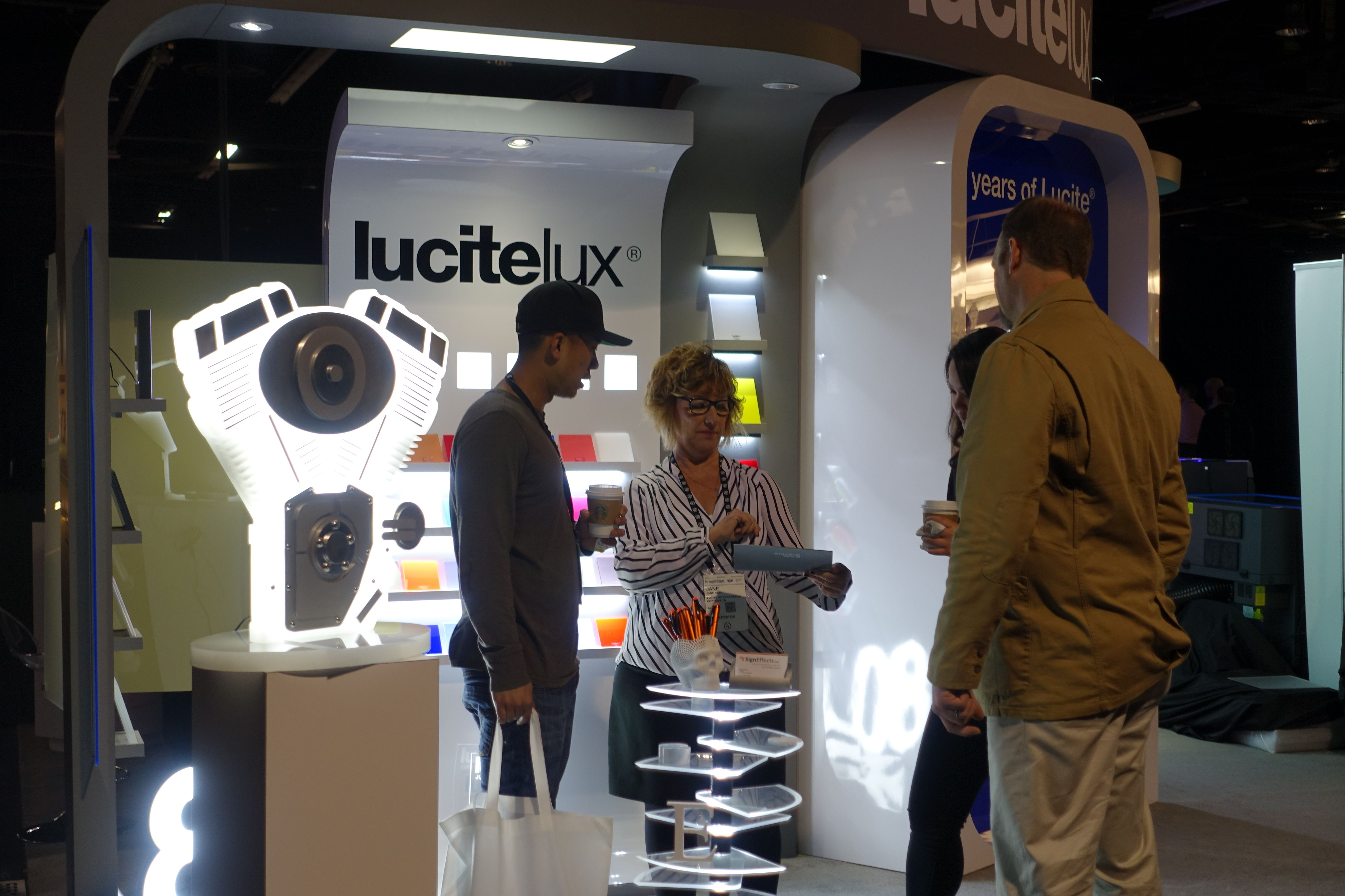 The LuciteLux® team in conversation with visitors to their booth at Lightspace California.