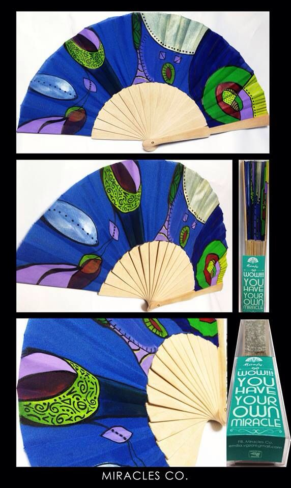 How lovely this fan is! Looks like a peacock design.