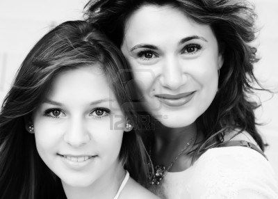 f1f2a8a3d37 Mother and teenage daughter outside Stock Photo