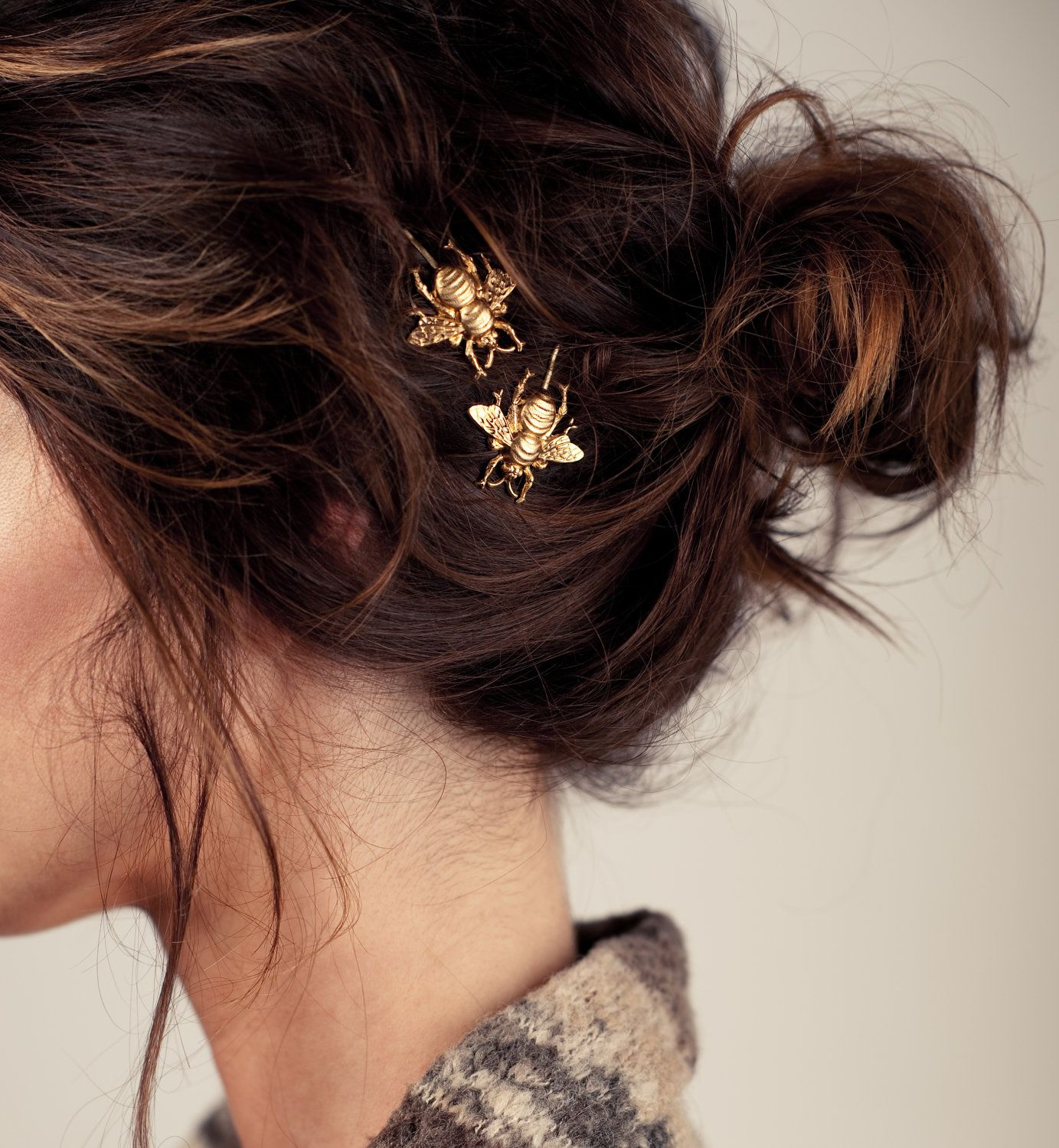 Golden bumble bee bobby pins perfectly at home nestled in a messy
