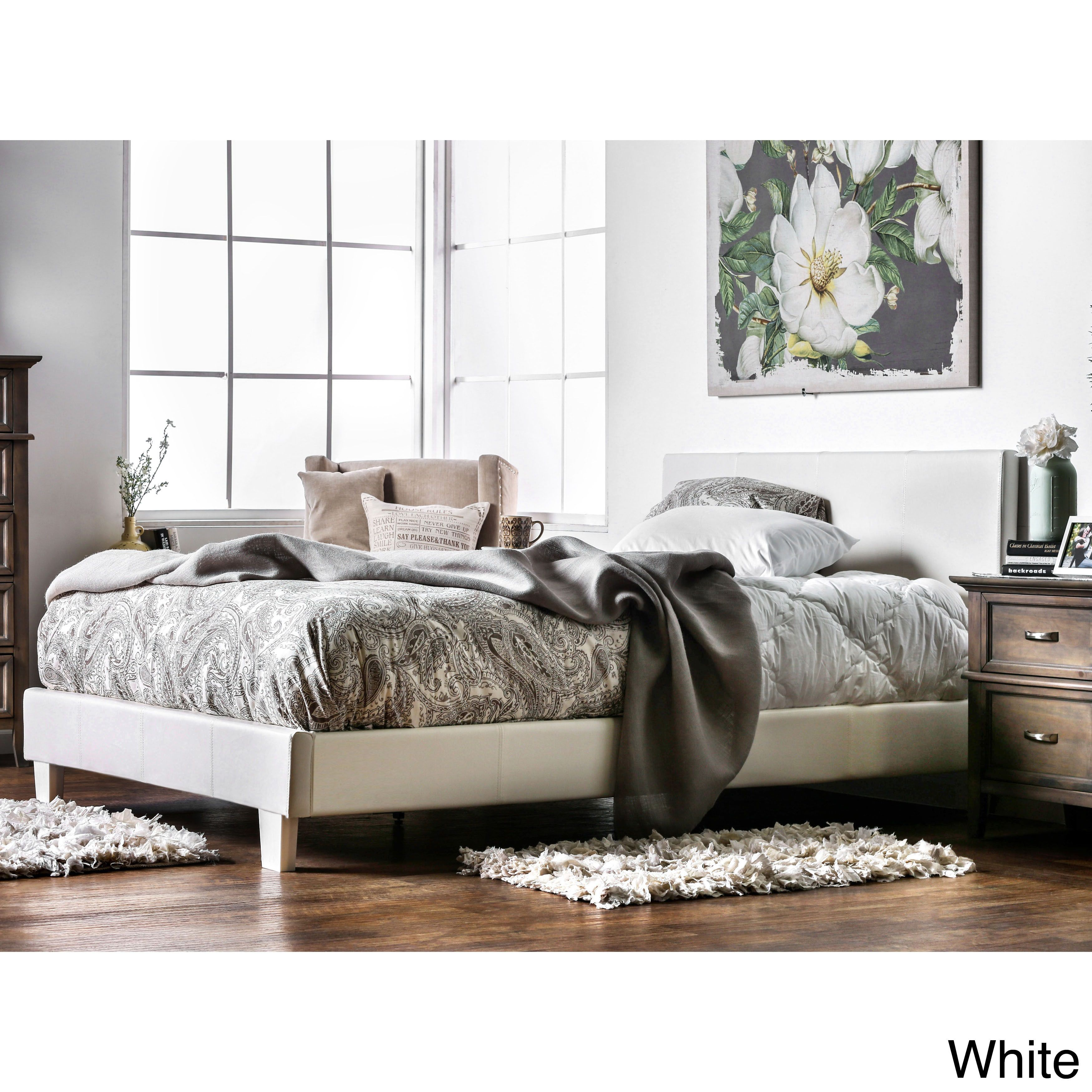 Elevate your bedroom decor with sophisticated style when you add this platform bed to your collection. This leatherette or fabric upholstered bed is made with an expertly crafted solid wood frame that