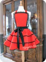 About emmanuella koeing... - Trophy-Wife Aprons   lets jus say she does amazing aprons I havent boughten one yet but from what i can see from pictures of other people wearing aprons emmanuella has made looks fregin amazing. :)
