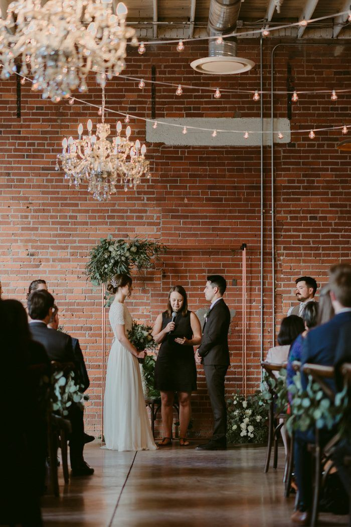 This couple brought rustic details to this industrial wedding venue | Image by Wolf N Fox Photography