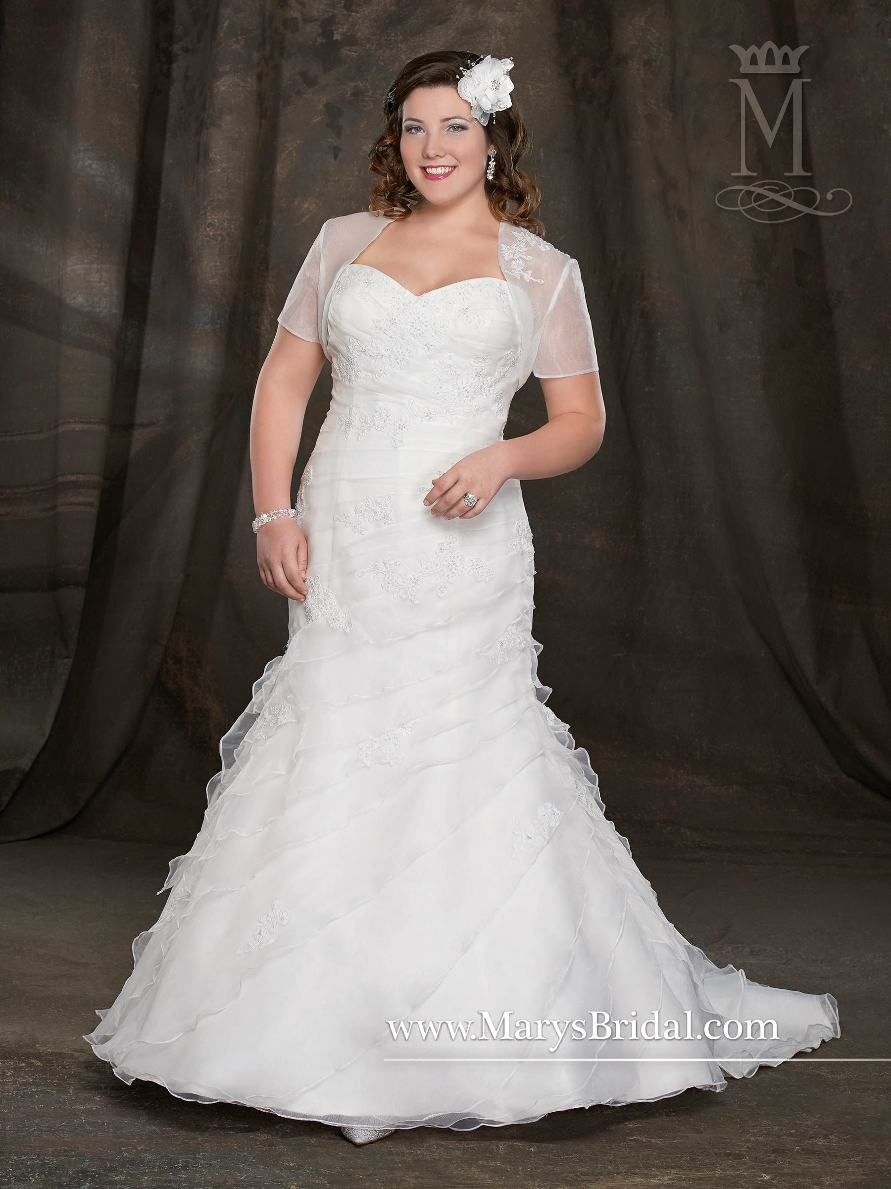 Style this organza mermaid gown with figureflattering ruching
