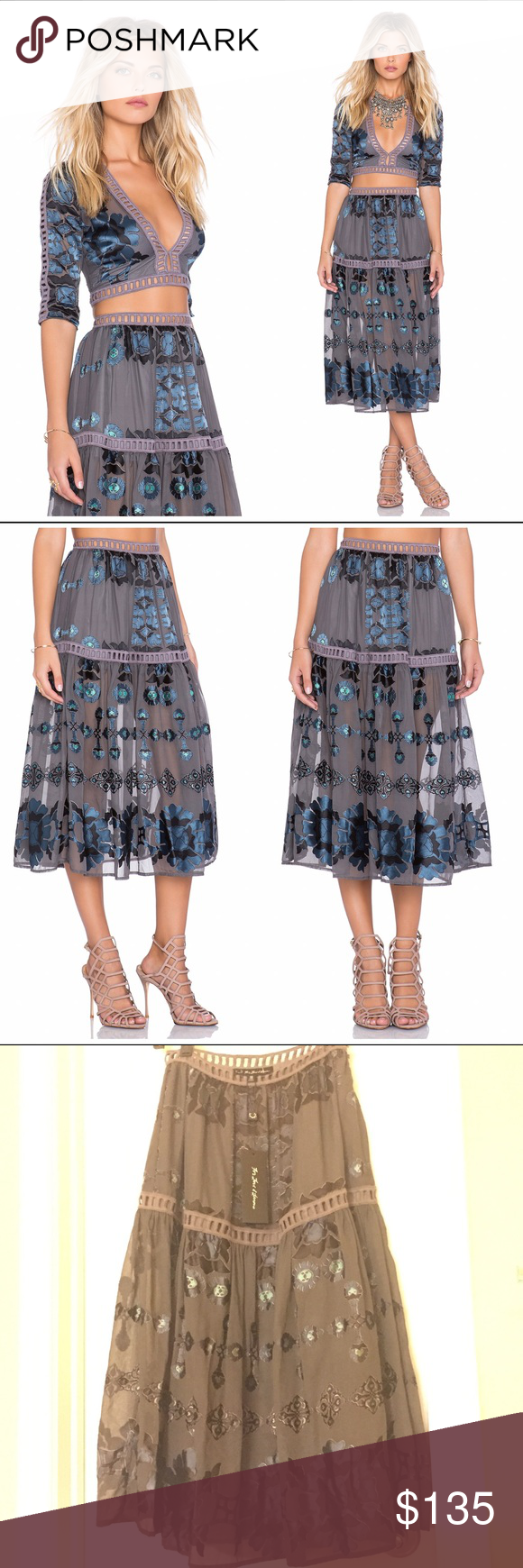 For Love and Lemons Barcelona midi skirt Super adorable for love and lemons Barcelona midi skirt in blue. The skirt is the prettiest mix of blues, grey, and purple! Size small (runs true to size) great for summer! It is lined For Love and Lemons Skirts Midi
