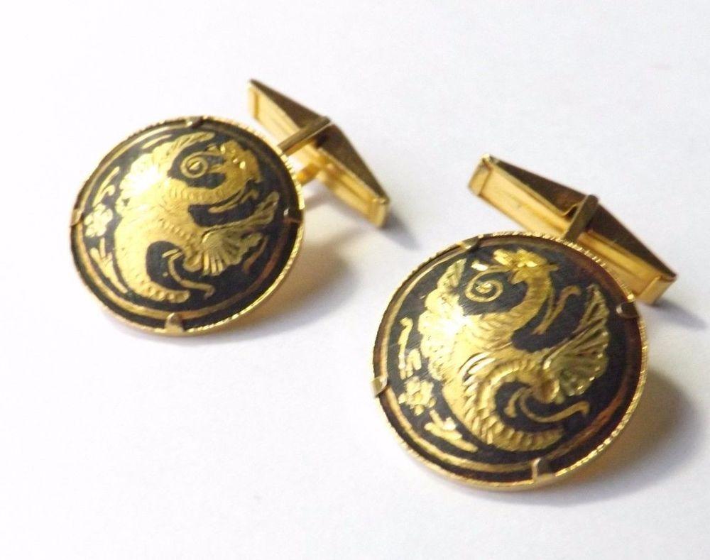 Damascene gold tone cuff links.