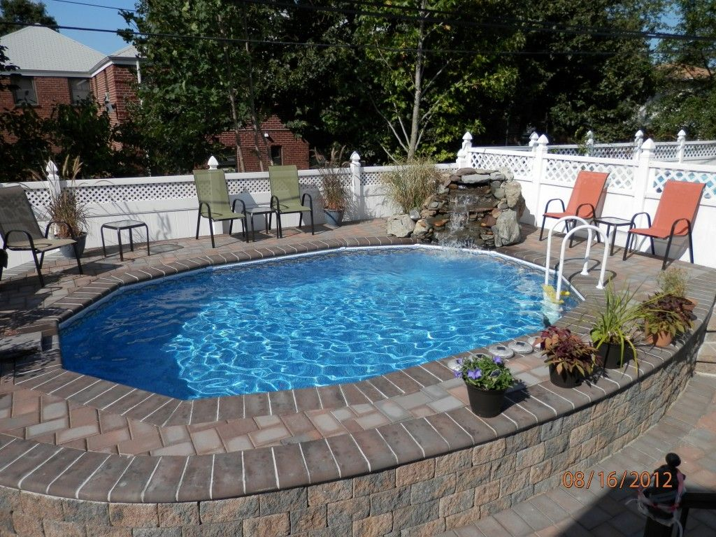 Semi inground pools with decks high rise semi inground for Pool deck decor ideas