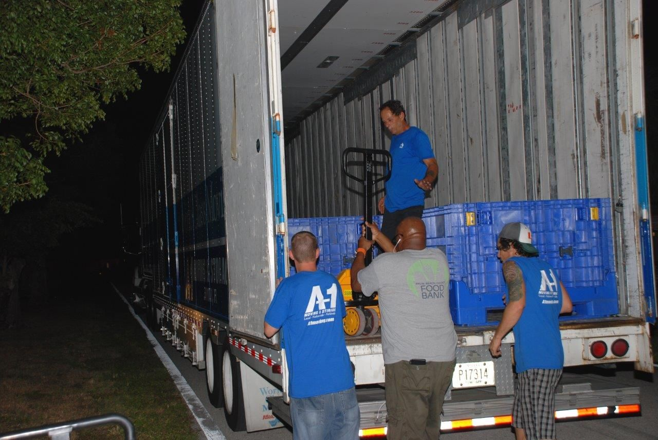 A 1 Moving And Storage Provided Two Trucks And Crews To Assist With The  U201cdeCANstructionu201d And Transportation Of The Canned And Packaged Foods.