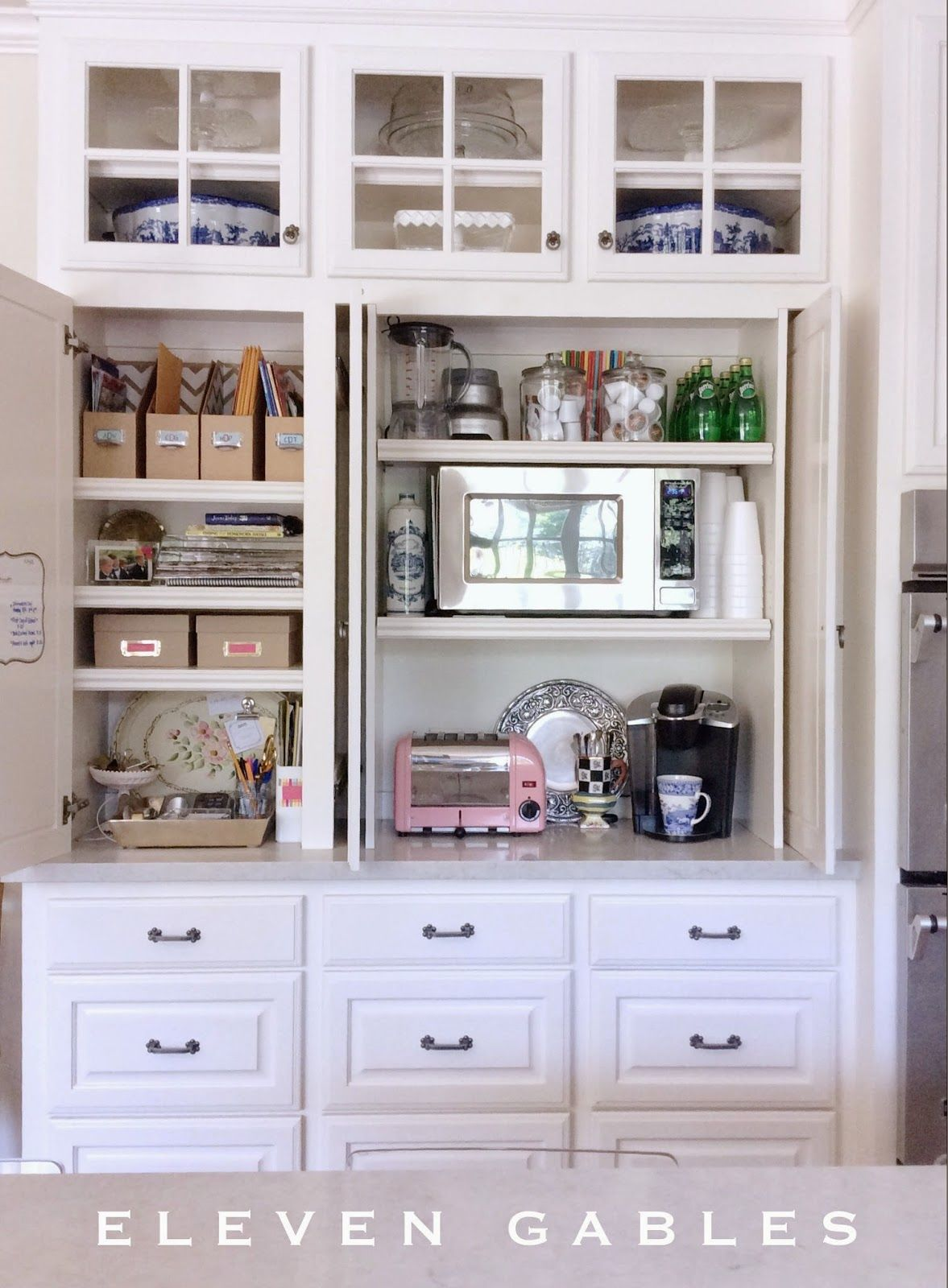 Hidden appliance cabinet and desk command center in the for Hidden kitchen storage ideas