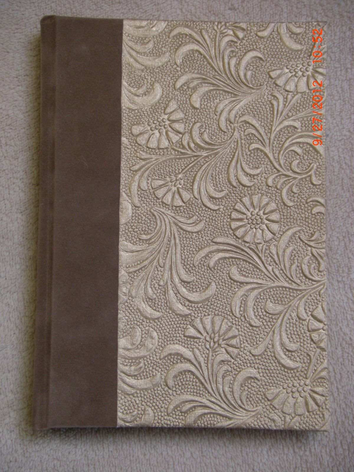 Blank journal with imitation suede spine and embossed golden flowers on cover. Made by Roxanne