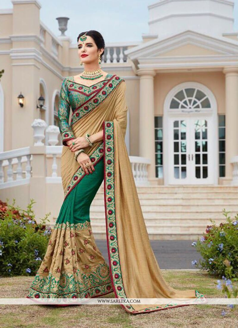 19de7de96a3cb1 Real beauty will come out of your dressing design with this beige and green  faux georgette half n half designer saree. The ethnic embroidered, patch  border ...