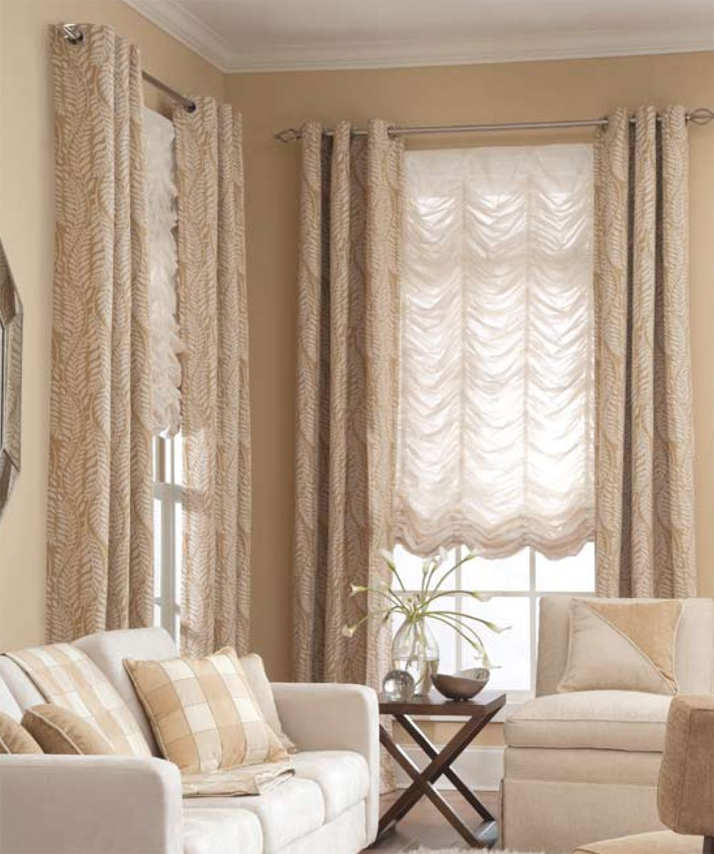 This white shade matches the neutral scheme of this room. Additionally, it is accompanied by another window treatment on both sides. To purchase this, visit decorativedirections.com