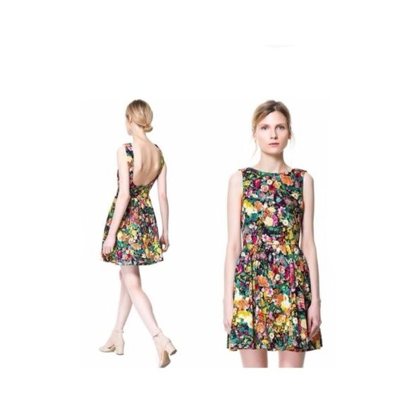 3d9c2f31 Zara Pleated Floral Open Back Dress Gorgeous Zara dress featuring pleated  front & dramatic open back. This dress is stunning!