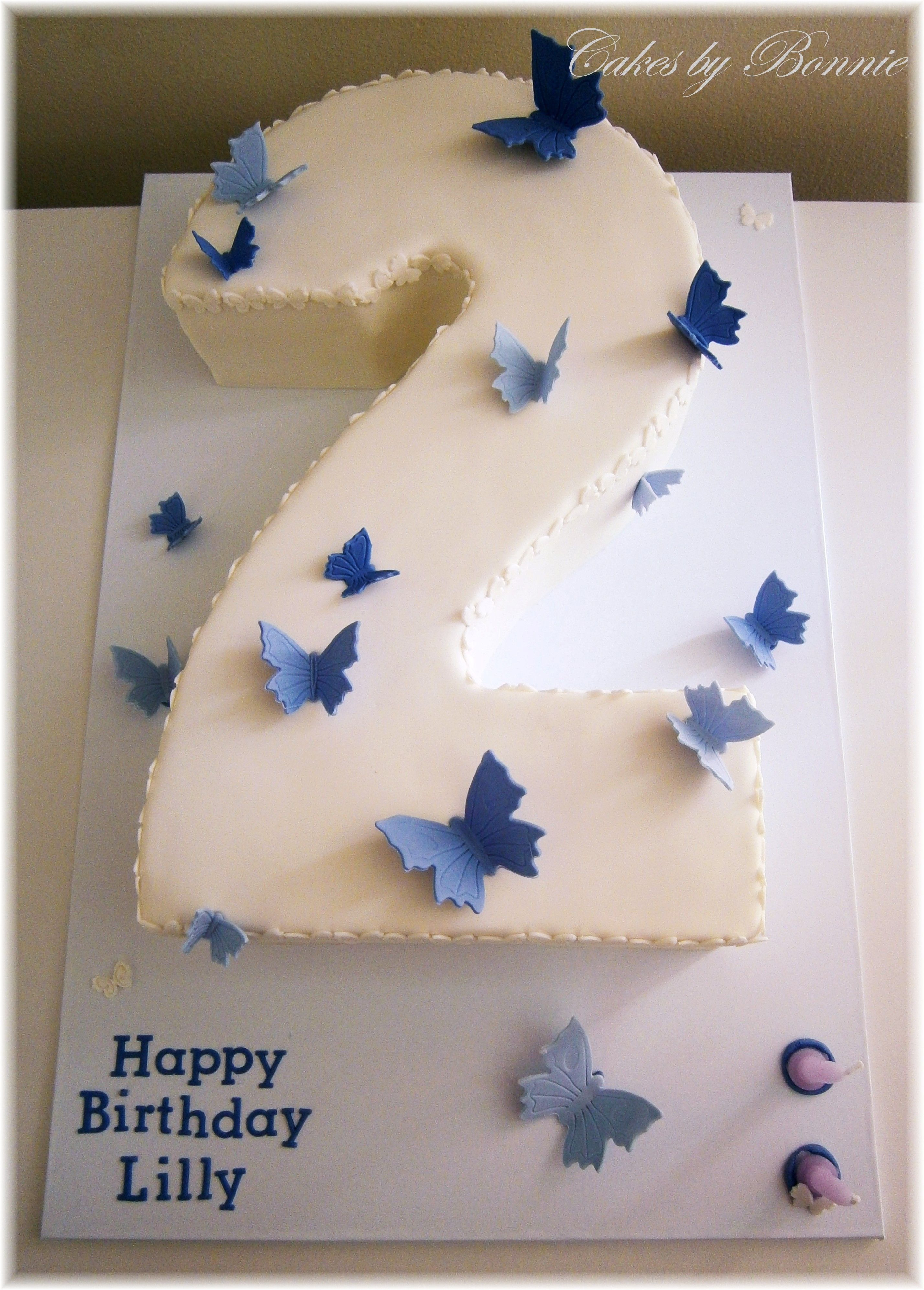number 2 shaped cake with purple butterflies Cakes by Bonnie