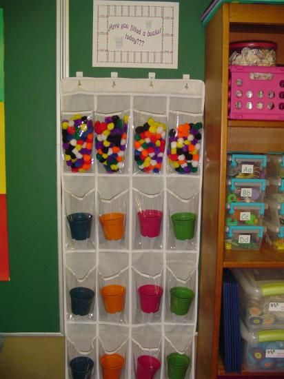 Pockets will be labeled with students names.  We will fill each other's buckets with pom poms when we do something  helpful or kind for someone in our room. When the bucket is full, each student will receive a sticker on a chart to commemorate their full bucket.