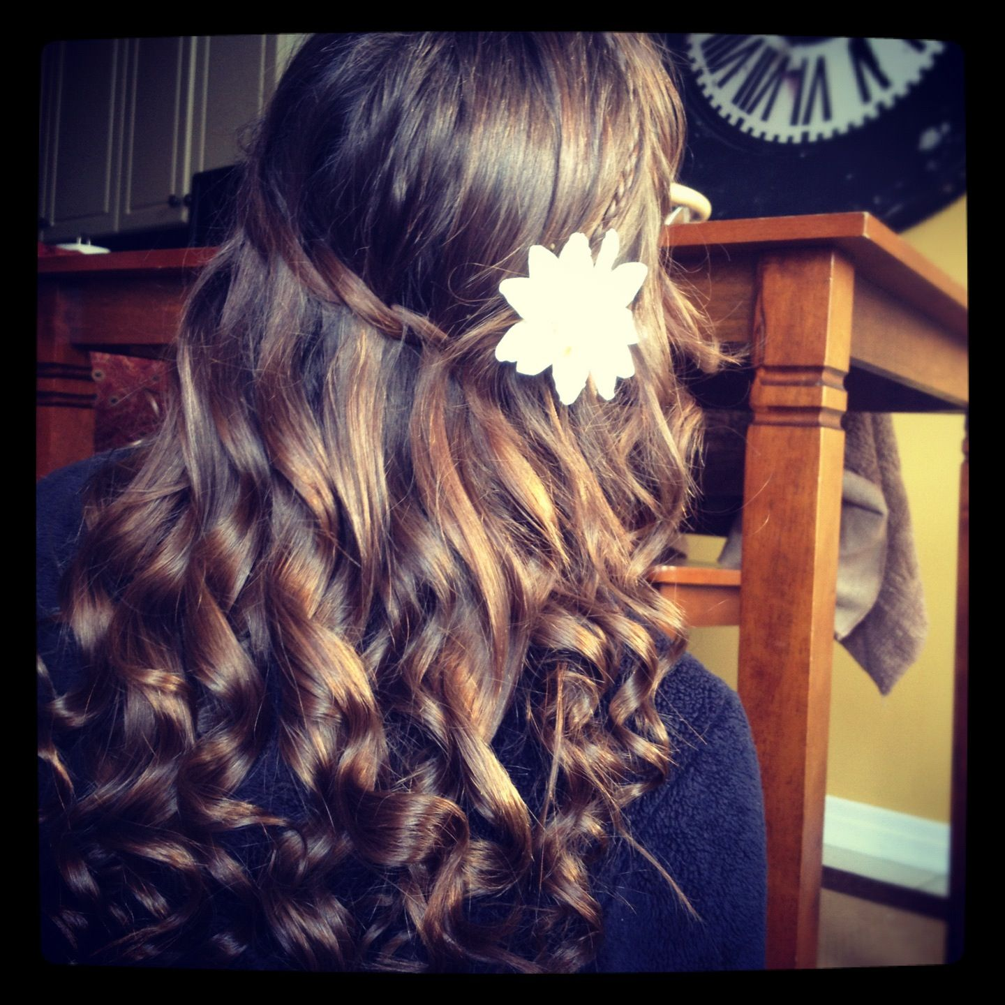 Cute waterfall braid curly hair with a flower for a nice touch