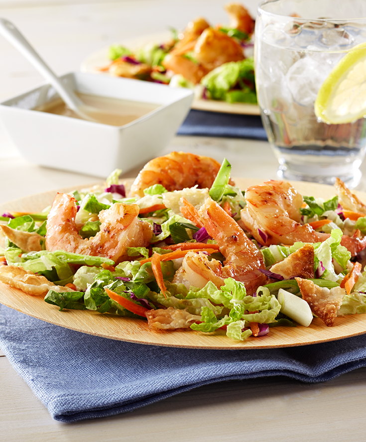 A fresh Asian-inspired salad, topped with shrimp and homemade dressing.