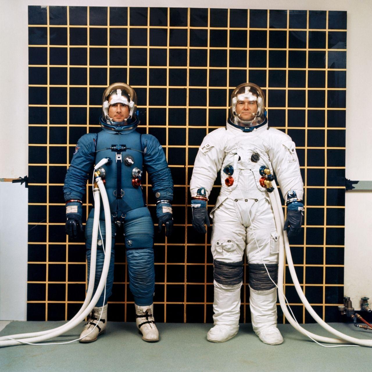 Astronauts Irwin and Bull model the Apollo IVA