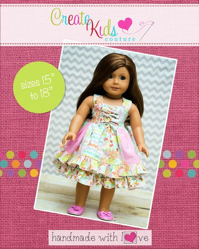 This adorable doll dress has Create Kids Couture written all over it! Not only is it our popular reverse knot bodice that everyone loves, but it also has a stripwork design on it, double layers for extra twirl, and RUFFLES! This dress is sure to be a staple in your doll's wardrobe or a favorite in your boutique!